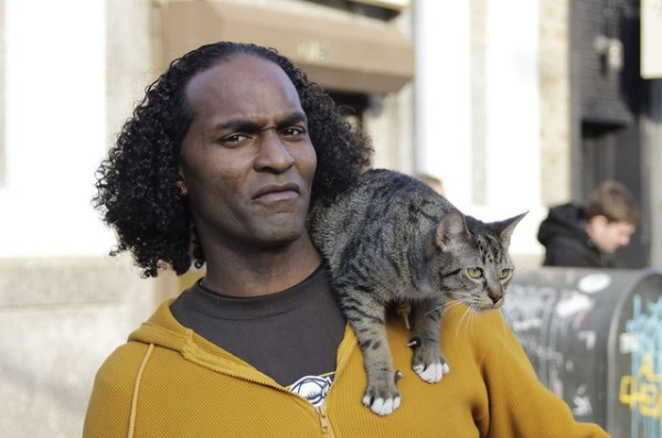 Man with shoulder cat