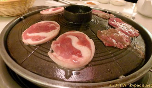 Useolgui (ox tongue) and origui (duck) on barbecue