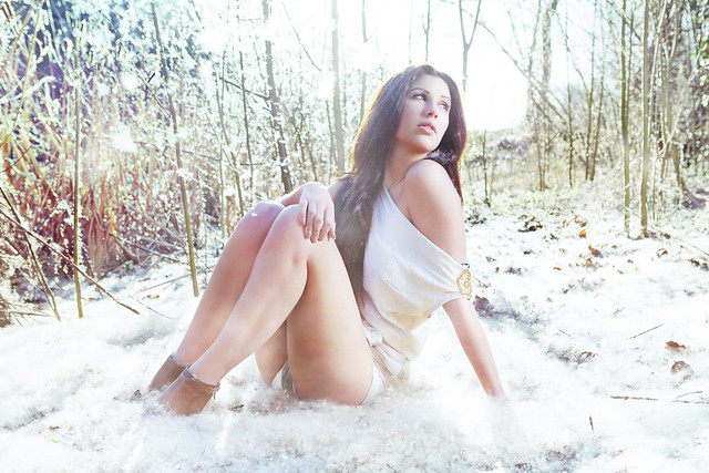 Beautiful girl woods fashion portrait snow