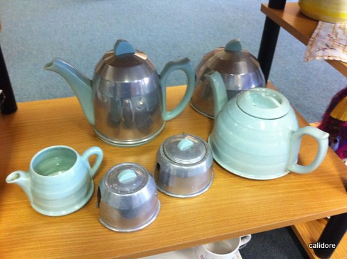 Metal Tea cosies, lined with felt, that slip over china tea pots
