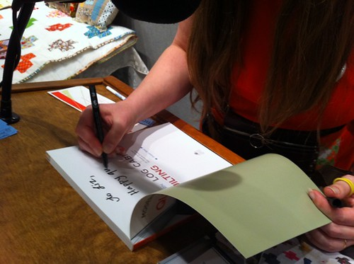 Signing a book for Liz