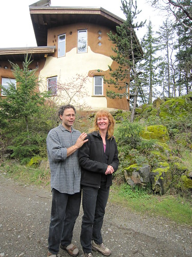 Ann and Gord in front of their cob residence