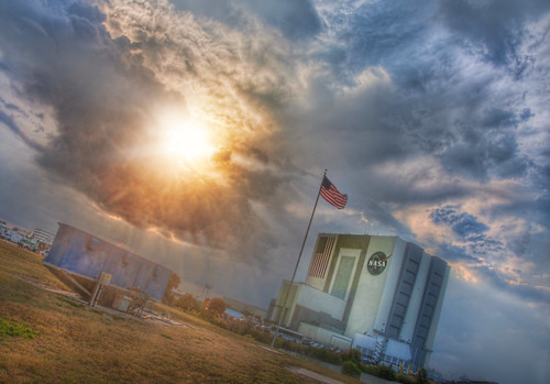 Sun Busting Through Stormclouds at NASA by Stuck in Customs