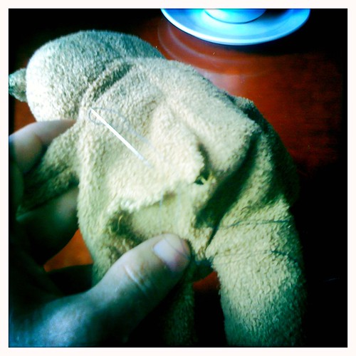 Important holiday preparation - sawing up the butt of Leos favorite teddybear :)