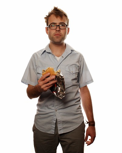 Impromptu Portrait of a Young Man consuming a Hamburger