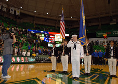 Sailors perform the national anthem before a b...