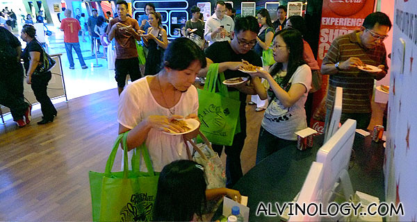 Guests enjoying the free flow of pizzas from Domino's