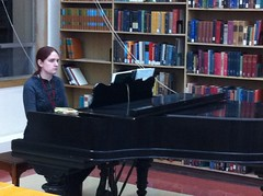 Christiana Hargrave playing the piano at Cushing Library