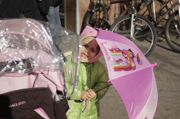Child with umbrella with Dora the Explorer with umbrella