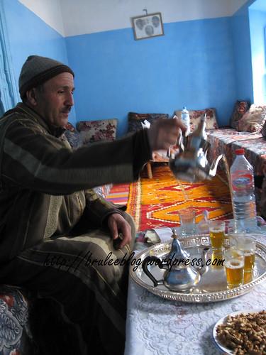 Mohamed pours mint tea