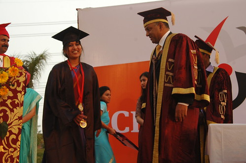 Ankita Gupta, winner of the medals for excellence, with Sanjeev