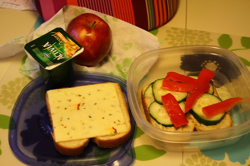 Activia dessert peach cobbler, veggie sandwich with hummus, apple