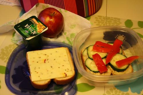 Activia dessert peach cobbler, veggie sandwich with hummus, apple