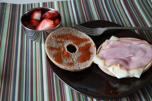 ham and swiss on a bagel thin; strawberries