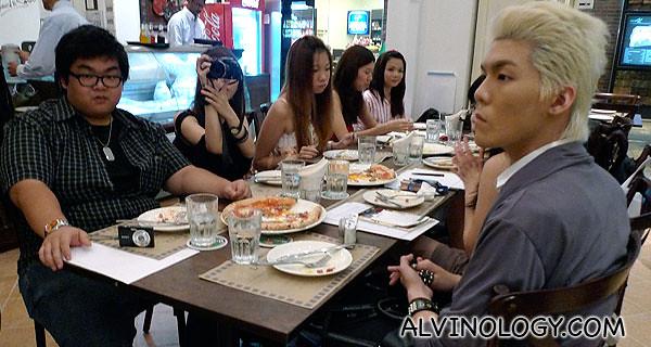 The bloggers enjoying their pizzas