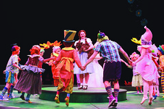 Emily Walton as Dorothy and the Junior Company as munchkins in The Wizard of Oz produced by Music Circus at the Wells Fargo Pavilion June 21 -30, 2013. Photo by Charr Crail.