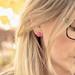 She is wearing pink earrings