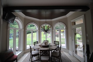 Hand-scraped Pine Beam and Ceiling sets off this breakfast nook.#langecustoms