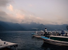 Day 249. To withdraw money I had to take a boat to San Pedro, a slightly larger city across the lake. I didn't realize public boats stopped running at five, so was forced to barter with a boat owner on prices back to San Marcos. Snapped this shot while we