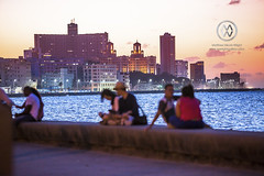 People gather on the Malecon for sunset.