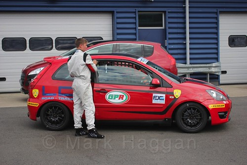 Bradley Burns gets out of his car after Race 2, Fiesta Junior Championship, Rockingham, Sept 2015