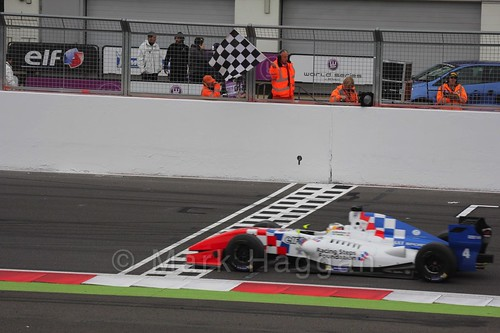 Oliver Rowland takes the chequered flag in Saturday's Formula Renault 3.5 Race at Silverstone