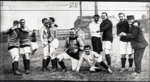 Group of Manchester United players clowning during a training session, Old Trafford, c.1910