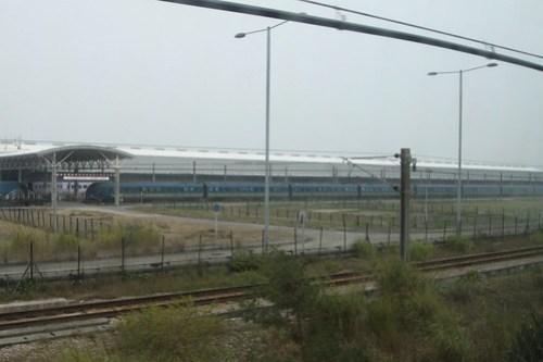 Airport Express train beside the main shed at Siu Ho Wan depot