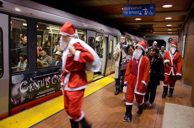 Santas & A Christmas Carol at Castro muni station