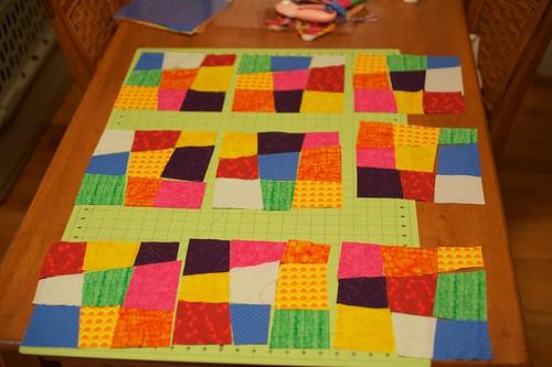 Crazy 9 Patch quilt squares laid out