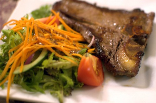 T-bone steak with salad