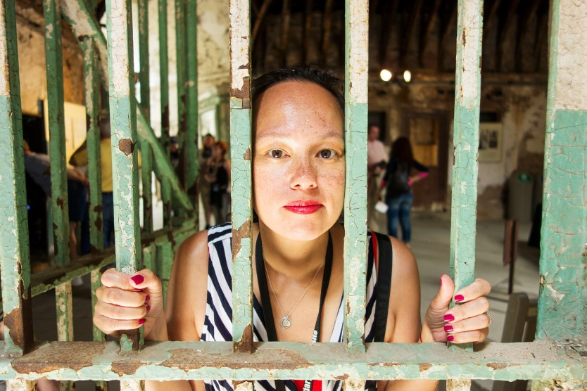 Glinda behind bars at Eastern State Penitentiary.