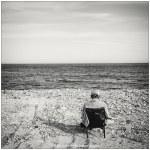 Lonly Sunbath Elderly Man Sitting Alone In A Chair Sunbath