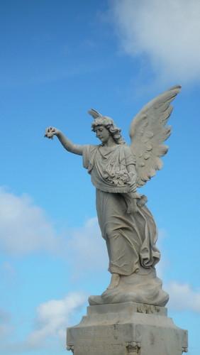 An angel as a memorial, against a blue sky