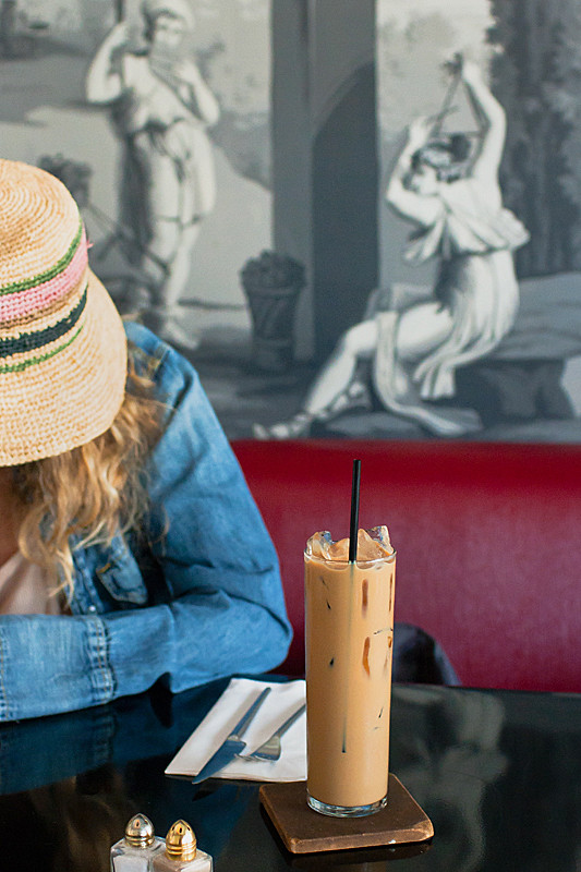woman with hat and iced coffee at lamill by Jackie Alpers