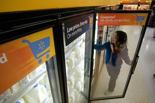 Walmart Retail Customer Selects Milk for Her Family