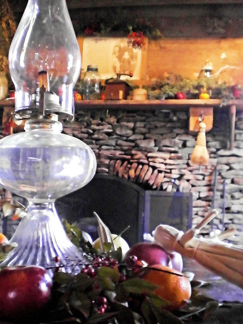 Oil lamp in front of decorated cabin fireplace