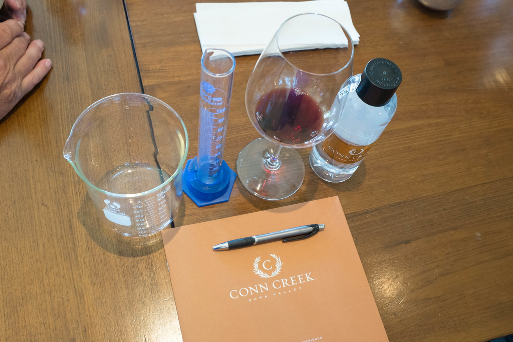 it's all about math: beakers to measure the amount of wine used to blend