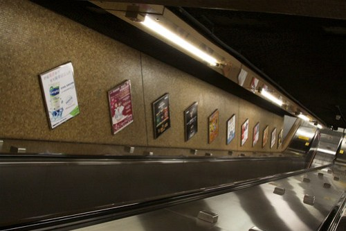 Escalators and advertising at Sheung Wan station