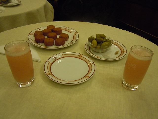 Bellinis, delicious chicken cakes and olives