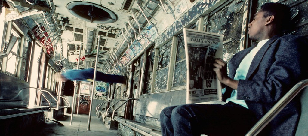 Man walking on subway car wall 4