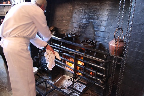 Charlecote Park: A chef cooking in the kitchen