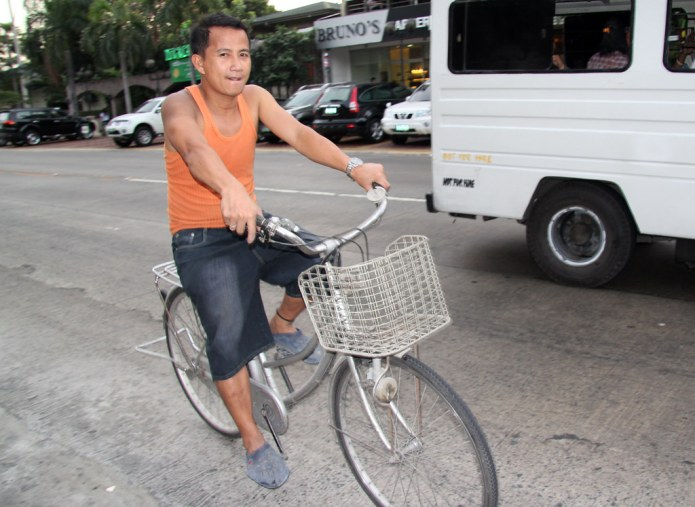 man on a bicycle with a basket