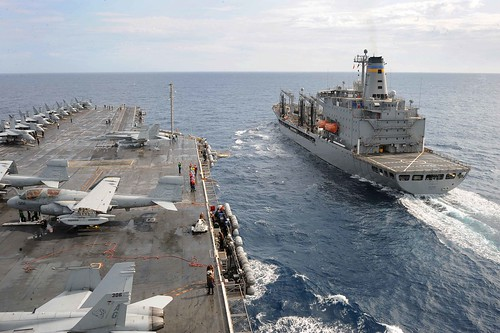 USS Dwight D. Eisenhower conducts a replenishment at sea.  by Official U.S. Navy Imagery