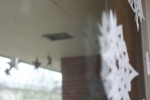 snowflakes inside and twirling stars outside