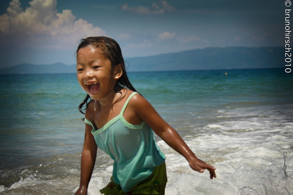 Happy kid on the Beach in The Philippines