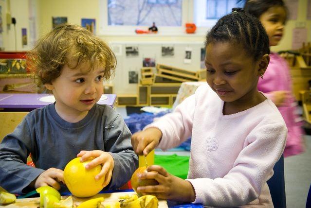 Children enjoying fresh fruit at a LEYF community nursery