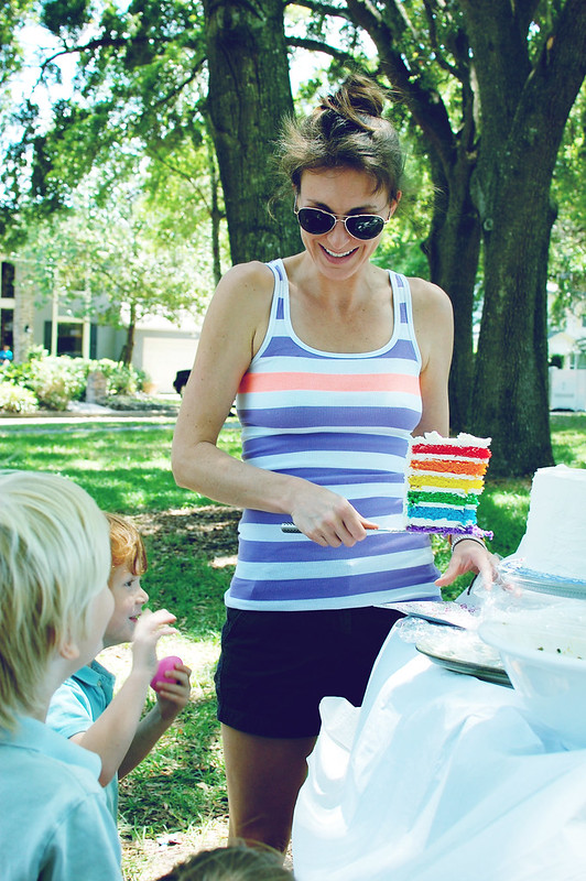 cutting into rainbow cake