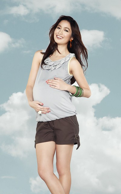 [Photo 2b] - Brown maternity shorts, light gray sleeveless top with neck details