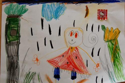 Lena tekent een vrolijk meisje